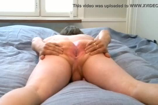 Boy spreading and wanking on bed
